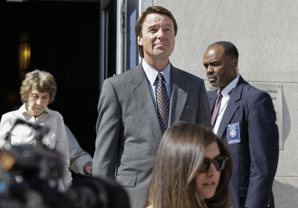 Former presidential candidate and Sen. John Edwards, center, leaves a federal courthouse in Greensboro, N.C., Monday, May 7, 2012. Edwards is accused of conspiring to secretly obtain more than $900,000 from two wealthy supporters to hide his extramarital affair with Rielle Hunter and her pregnancy. He has pleaded not guilty to six charges related to violations of campaign-finance laws. (AP Photo/Chuck Burton)