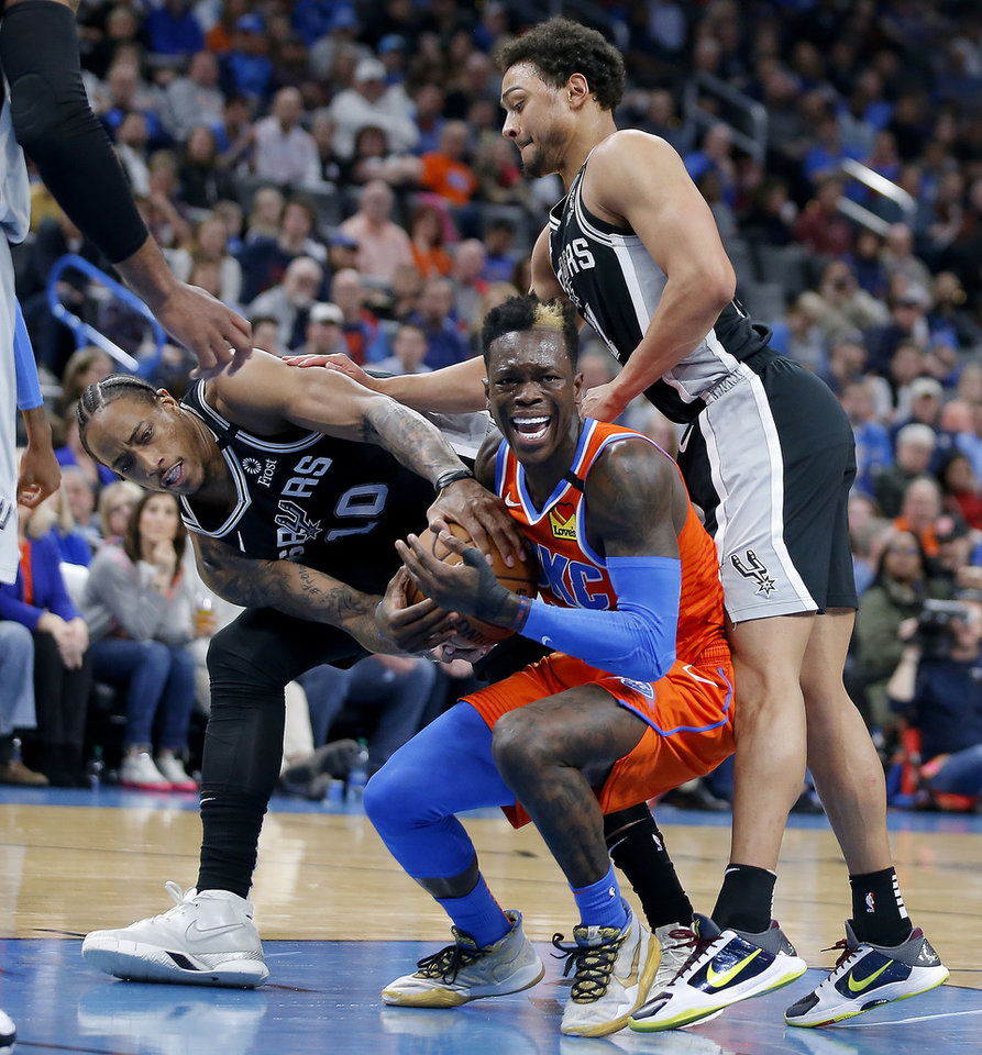 Photo - Oklahoma City's Dennis Schroder (17) fights for the ball with San Antonio's DeMar DeRozan (10) under Bryn Forbes (11) during an NBA basketball game between the Oklahoma City Thunder and the San Antonio Spurs at Chesapeake Energy Arena in Oklahoma City, Sunday, Feb. 23, 2020. Oklahoma city won 131-103. [Bryan Terry/The Oklahoman]