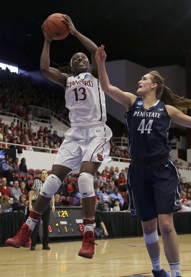 Photo - FILE - In this March 30, 2014 file photo, Stanford forward Chiney Ogwumike (13) shoots against Penn State forward/center Tori Waldner (44) during the first half of a regional semifinal game at the NCAA college basketball tournament in Stanford, Calif. Ogwumike was selected to The Associated Press women's basketball All-America team, released Tuesday, April 1, 2014. (AP Photo/Jeff Chiu, File)