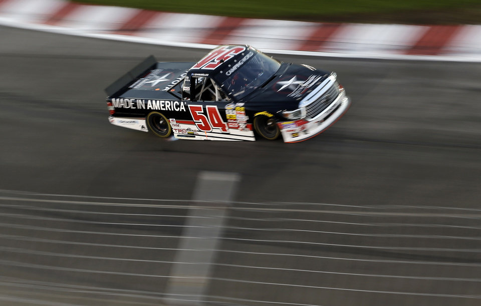 Photo - Darrell Wallace Jr. makes his way through Turn 1 during the NASCAR Truck Series auto race at Gateway Motorsports Park on Saturday, June 14, 2014, in Madison, Ill. (AP Photo/Jeff Roberson)