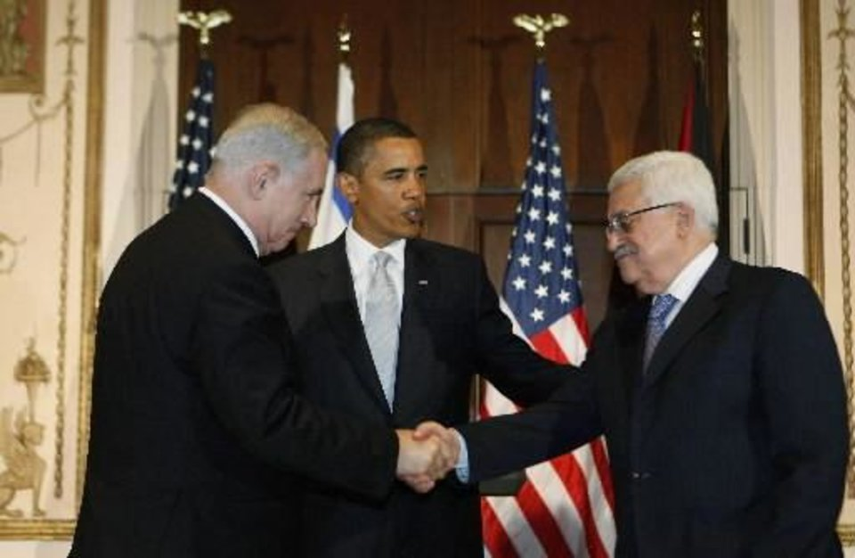 President Barack Obama watches as Israeli Prime Minister Benjamin Netanyahu and Palestinian President Mahmoud Abbas shake hands, in this Sept. 22, 2009 file photo taken in New York. President Obama won the 2009 Nobel Peace Prize Friday Oct. 9, 2009 for