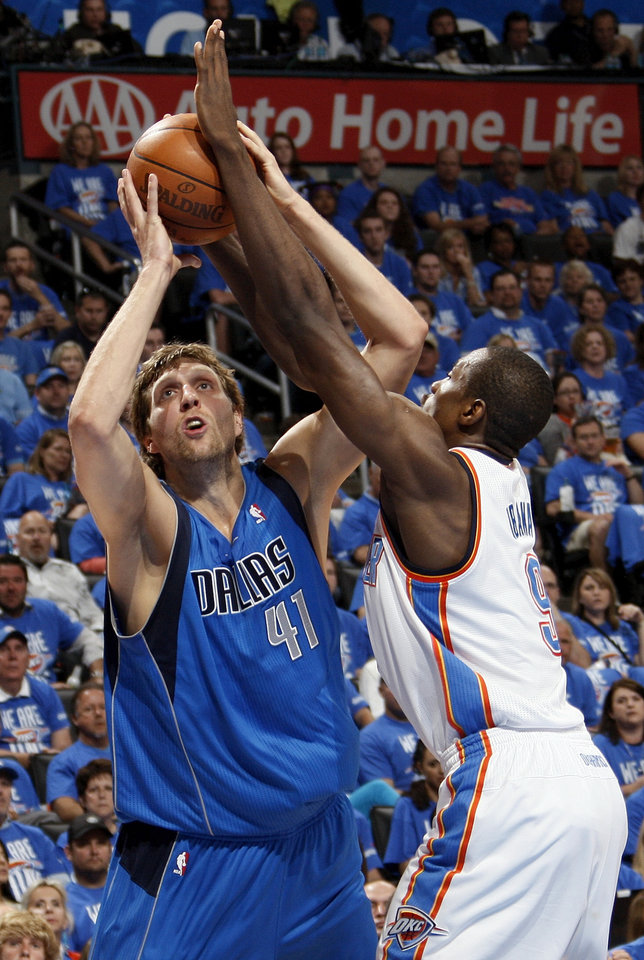 Photo - Dallas' Dirk Nowitzki (41) shoots against Oklahoma City's Serge Ibaka (9) during game one of the first round in the NBA playoffs between the Oklahoma City Thunder and the Dallas Mavericks at Chesapeake Energy Arena in Oklahoma City, Saturday, April 28, 2012. Photo by Nate Billings, The Oklahoman