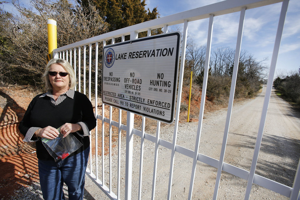 Left: Carolyn Pimsler stands Feb. 8 at the entrance to a proposed skeet shooting range on SE 119. Photo By Steve Gooch,  The Oklahoman