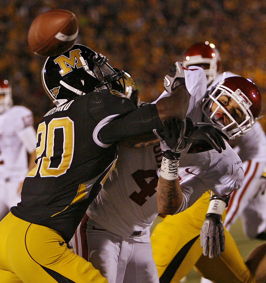 Photo - Missouri's Kevin Rutland (20) breaks up a pass for a two point conversion on Oklahoma's Kenny Stills (4) during the second half of the college football game between the University of Oklahoma Sooners (OU) and the University of Missouri Tigers (MU) on Saturday, Oct. 23, 2010, in Columbia, Mo. Oklahoma lost the game 36-27. Photo by Chris Landsberger, The Oklahoman