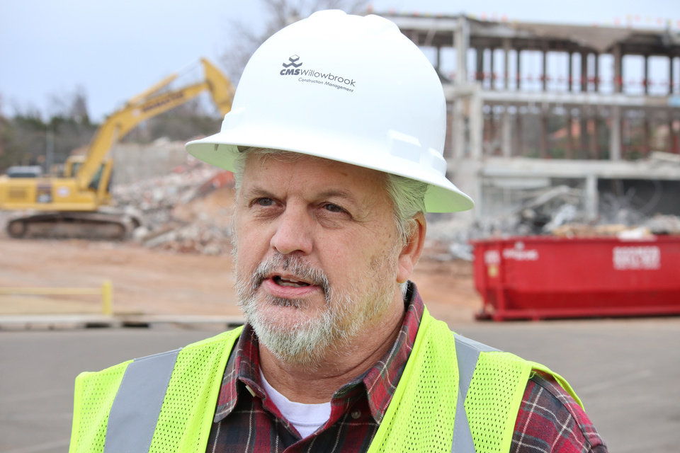 Photo -  Wayne Leatherbury, project manager for CMS Construction, talks Thursday about demolishing the former Oklahoma Wildlife Building. [Photo by Doug Hoke, The Oklahoman]