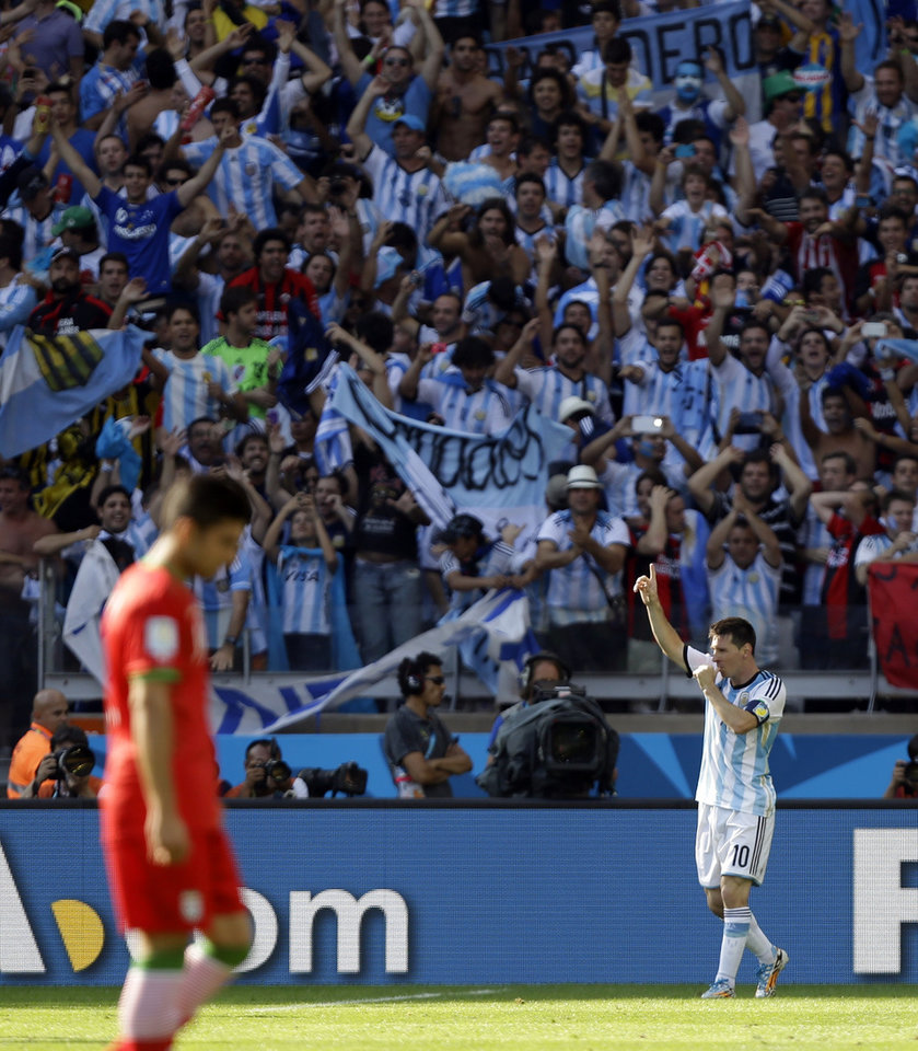 Photo - Argentina's Lionel Messi, third left, celebrates with teammates after scoring his side's lone goal in Argentina's 1-0 victory over Iran during the group F World Cup soccer match between Argentina and Iran at the Mineirao Stadium in Belo Horizonte, Brazil, Saturday, June 21, 2014. (AP Photo/Fernando Vergara)