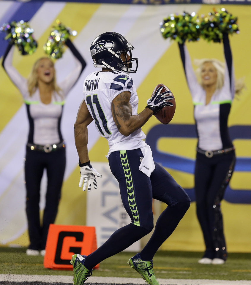 Photo - Seattle Seahawks' Percy Harvin celebrates after a touchdown against the Denver Broncos during the second half of the NFL Super Bowl XLVIII football game Sunday, Feb. 2, 2014, in East Rutherford, N.J. (AP Photo/Ben Margot)
