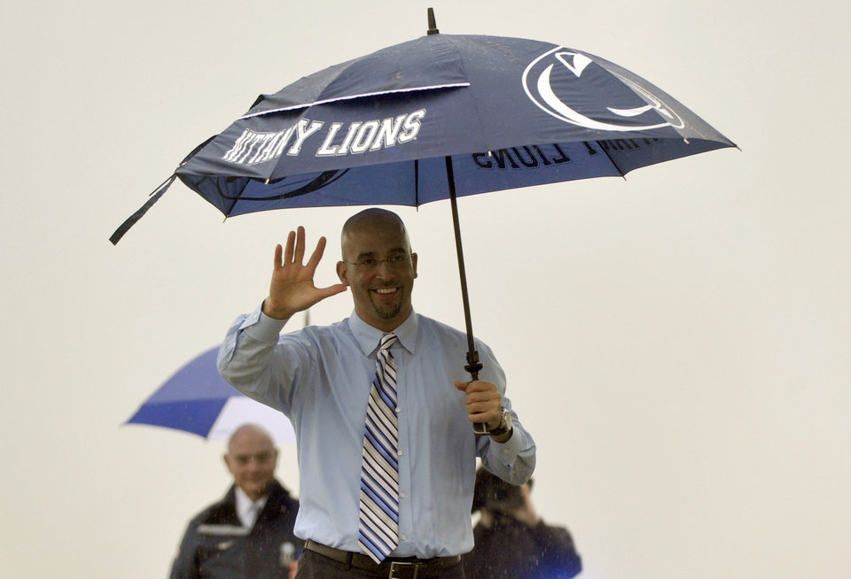Photo - James Franklin waves to reporters and fans gathered at University Park Airport in State College, Pa. on Saturday, Jan. 11, 2014.  Penn State has hired Franklin as its next head coach. Franklin, 41, who led Vanderbilt to bowls in all three of his seasons there, replaces Bill O'Brien, who left the Nittany Lions after two years to coach the NFL's Houston Texans. Penn State made the announcement Saturday, after the school's compensation committee met to finalize the contract.  (AP Photo/Centre Daily Times, Christopher Weddle)  MANDATORY CREDIT