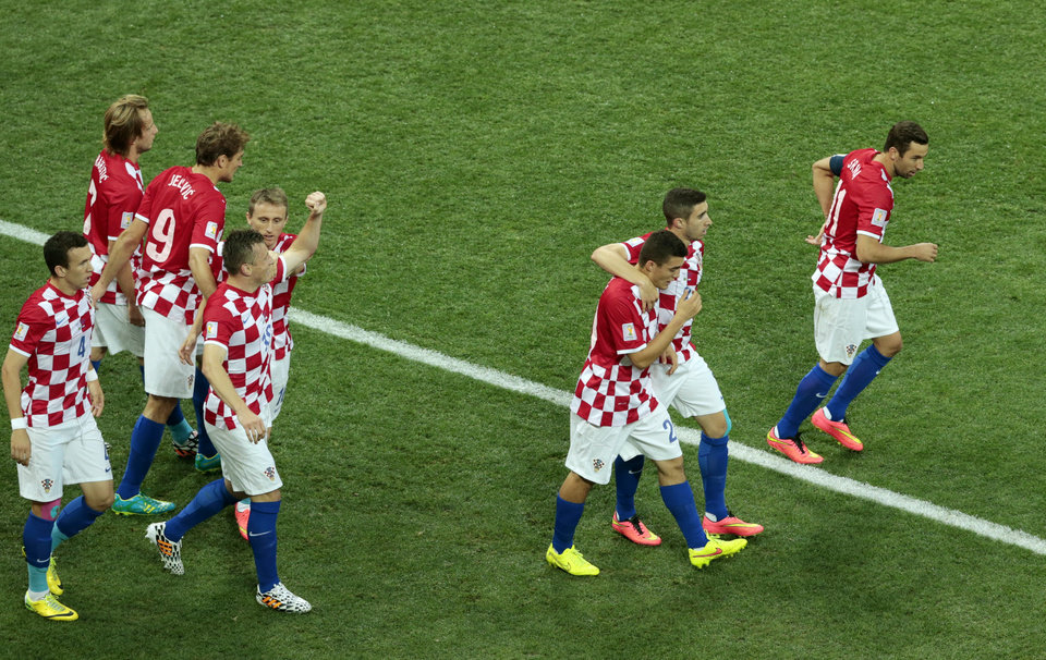 Photo - Croatia players celebrate after Brazil's Marcelo scored an own goal during the group A World Cup soccer match between Brazil and Croatia, the opening game of the tournament, in the Itaquerao Stadium in Sao Paulo, Brazil, Thursday, June 12, 2014. (AP Photo/Shuji Kajiyama)