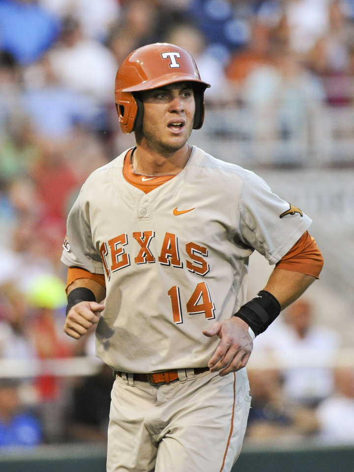 Photo - Texas' Ben Johnson who thought he had hit a triple reacts after being called out for not stepping on first base, in the sixth inning of an NCAA baseball College World Series elimination game against UC Irvine in Omaha, Neb., Wednesday, June 18, 2014. (AP Photo/Ted Kirk)
