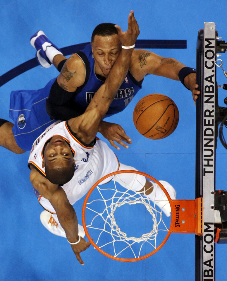 Photo - Oklahoma City's Russell Westbrook collides with Dallas' Shawn Marion while defending a shot by Marion during game one of the first round in the NBA playoffs between the Oklahoma City Thunder and the Dallas Mavericks at Chesapeake Energy Arena in Oklahoma City, Saturday, April 28, 2012. Oklahoma City won, 99-98. Photo by Nate Billings, The Oklahoman