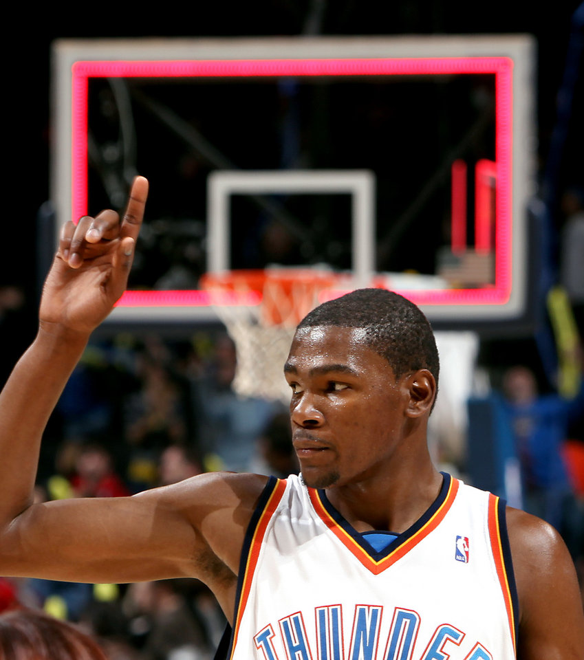 Oklahoma City's Kevin Durant salutes the home crowd as he walks off the court following the Thunder game against Philadelphia at the NBA basketball game at the Ford Center in Oklahoma City on Tuesday, Dec. 2, 2009. The Thunder beat the 76ers 117 to 106. By John Clanton, The Oklahoman