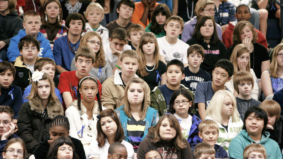 Photo - Edmond students attend an assembly at Cheyenne Middle School, recognizing the school's status as a National Blue Ribbon School. PHOTO BY PAUL HELLSTERN,  Oklahoman archive