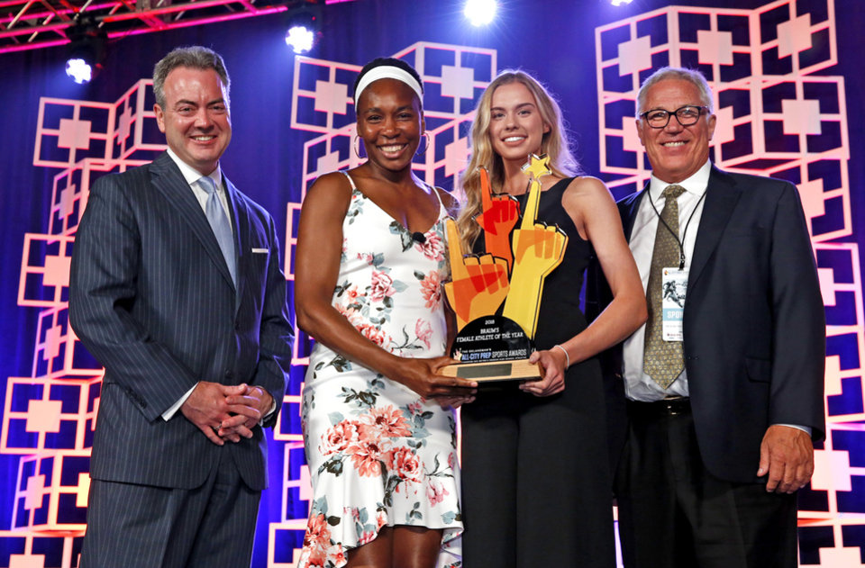 Photo -  Oklahoman Publisher Chris Reen, tennis icon Venus Williams and Drew Braum (right) present the female athlete of the year award to Haylee Swayze of Purcell during The Oklahoman's All-City Prep Sports Awards at the Cox Convention Center on Tuesday. [Photo by Steve Sisney, The Oklahoman]