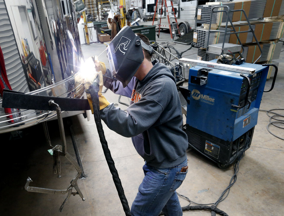 Joe Hackney welds at Cimarron Trailers in Chickasha.