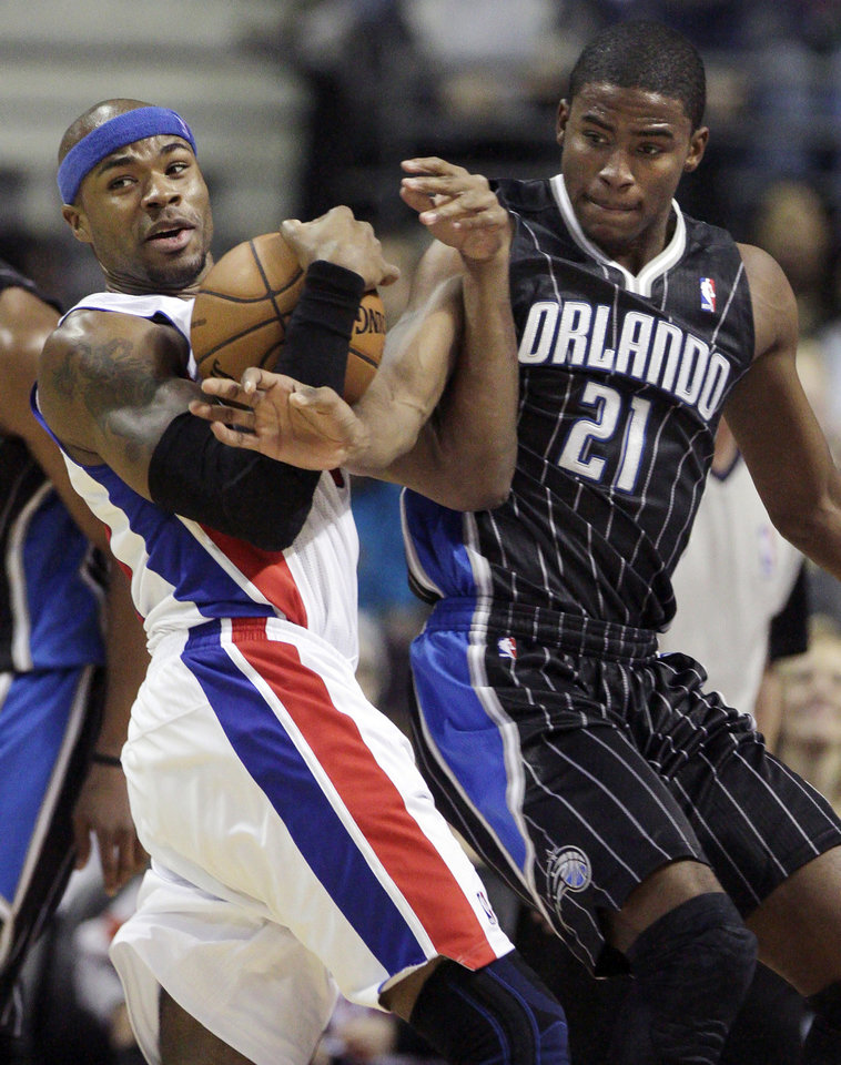 Photo -   Orlando Magic forward Moe Harkless (21) tries to steal the ball from Detroit Pistons forward Corey Maggette, left, in the first half of an NBA basketball game Friday, Nov. 16, 2012, in Auburn Hills, Mich. (AP Photo/Duane Burleson)