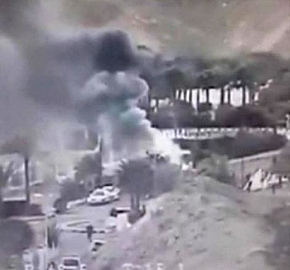 Photo - An image made from a video provided by the Israeli Airports Authority shows smoke  from the bombing of the bus carrying South Korean sightseers near the tip of the Red Sea's Gulf of Aqaba Sunday Feb. 16, 2014.  At least three South Korean tourists were killed and 12 seriously wounded, according to Egyptian security officials.   (AP Photo/Israeli Airports Authority)