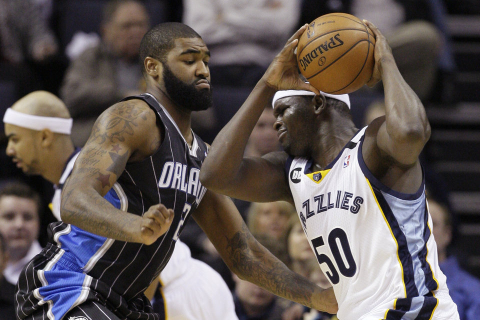 Memphis Grizzlies\' Zach Randolph (50) is pressured by Orlando Magic\'s Kyle O\'Quinn (2) during the first half of an NBA basketball game in Memphis, Tenn., Friday, Feb. 22, 2013. (AP Photo/Danny Johnston)