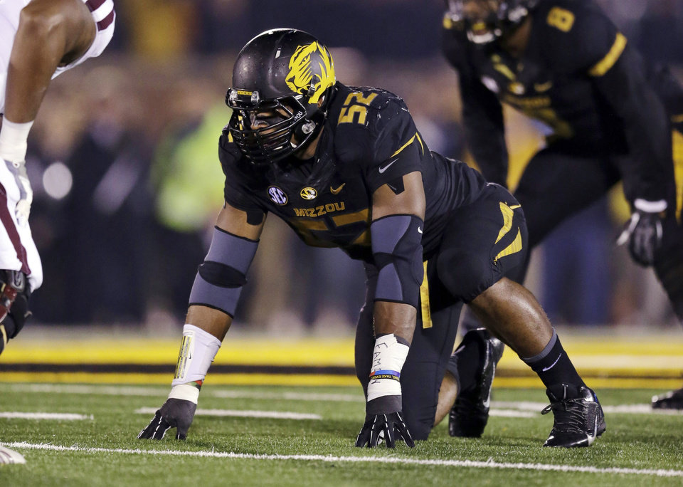Photo - FILE - In this Nov. 20, 2013, file photo, Missouri defensive lineman Michael Sam takes up his position during the first half of an NCAA college football game against Texas A&M in Columbia, Mo. Sam was selected in the seventh round, 249th overall, by the St. Louis Rams in the NFL draft Saturday, May 10, 2014. The Southeastern Conference defensive player of the year last season for Missouri came out as gay in media interviews this year. (AP Photo/Jeff Roberson, File)