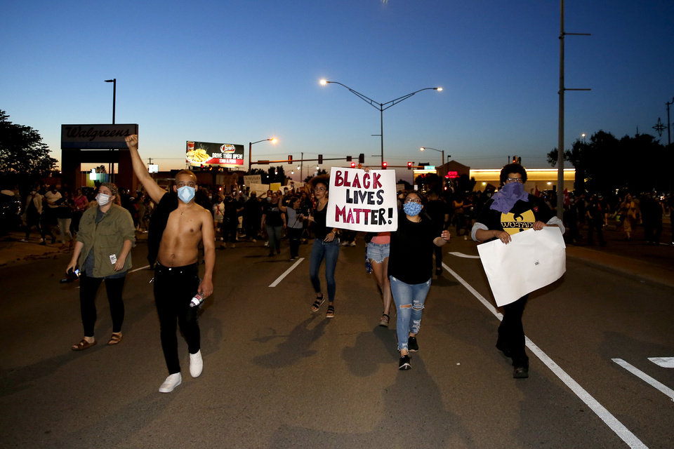 Photo - Protesters march south on Classen in Oklahoma City, Saturday, May 30, 2020. The protest was in response to the death of George Floyd. [Bryan Terry/The Oklahoman]