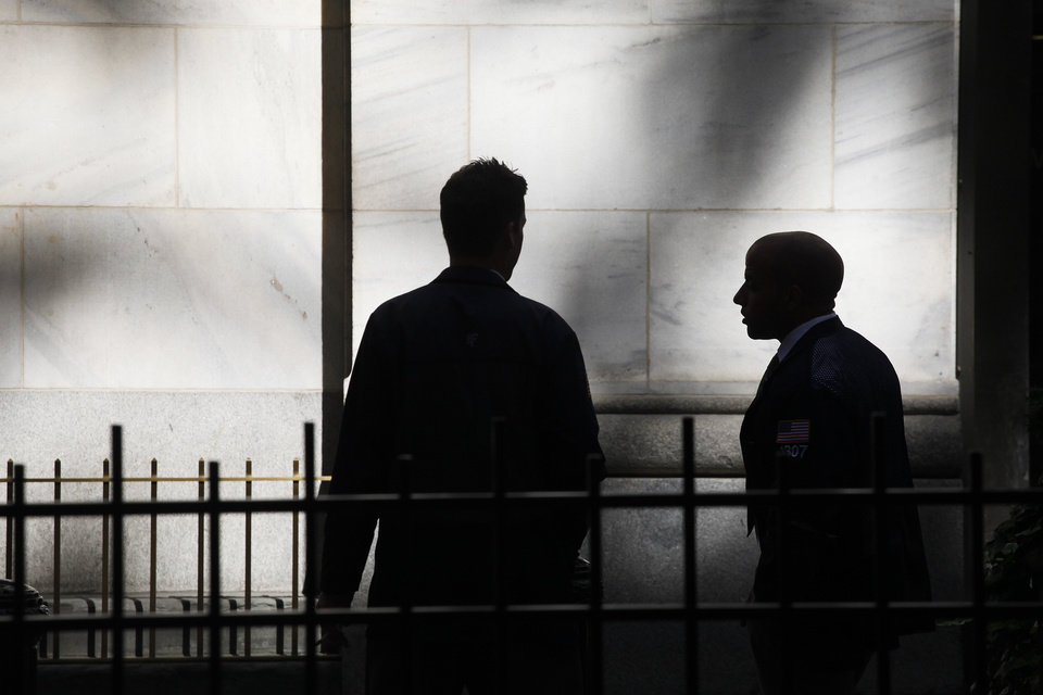 Photo - FILE - In this Monday, July 15, 2013, file photo, traders stand outside the New York Stock Exchange in New York. Stock futures are mixed with a poor quarter from McDonald's sending Dow Jones futures lower, Monday, July 22, 2013. (AP Photo/Mark Lennihan, File)
