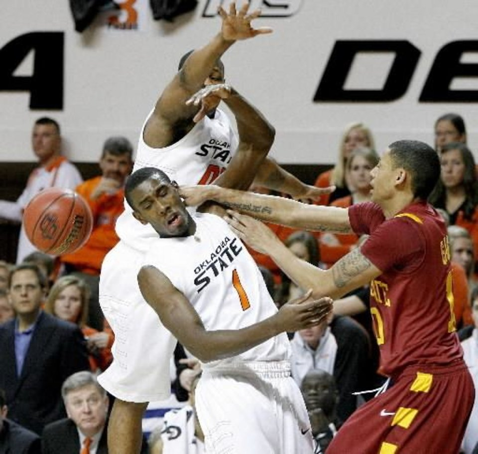 Photo - Oklahoma State's Terrel  Harris, left, and Byron  Eaton (1) put pressure on Iowa State's Diante Garrett as he passes the ball during an NCAA college basketball game in Stillwater, Okla., Saturday, Feb. 14, 2009. Oklahoma State won 86-67. (AP Photo/The Oklahoman, Bryan Terry)