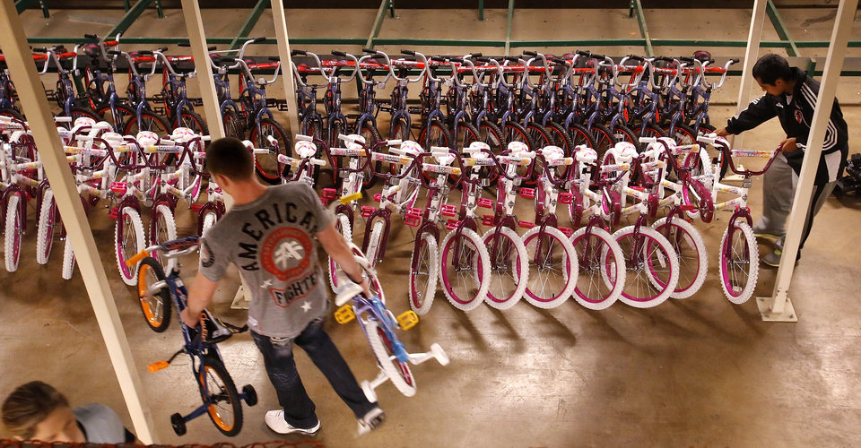 Assembled bikes are lined up waiting to be delivered to children. More than 150 volunteers donated their time and skills Saturday morning, Dec. 1, 2012,  assembling 830 childrens' bicycles for the SalvationArmy's bike giveaway project. The bicycles will be distributed to children in need  at Christmas. Bikes were assembled inside the former J.C. Penney store in the vacant Crossroads Mall.     Photo by Jim Beckel, The Oklahoman