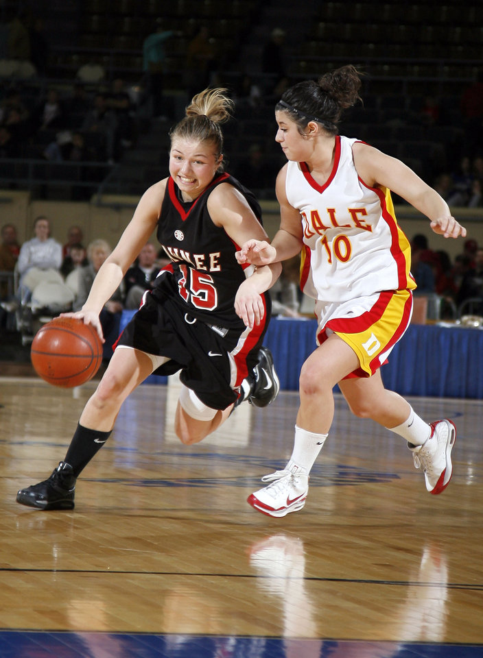 Photo - Pawnee's Britney Morgan (15) tries to get past Dale's Kaylee Wilkins (10) during the girls 2A semifinal between Dale and Pawnee at the State Fair Arena, Friday, March 13, 2009, in Oklahoma City. PHOTO BY SARAH PHIPPS, THE OKLAHOMAN