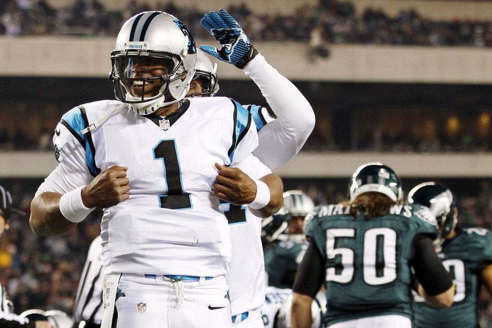 Photo -   Carolina Panthers quarterback Cam Newton (1) reacts after scoring a touchdown in the second half of an NFL football game against the Philadelphia Eagles, Monday, Nov. 26, 2012, in Philadelphia. (AP Photo/Mel Evans)