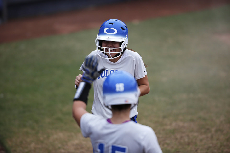 Oolagah's Olivia Slater (3) celebrates with her teammates after scoring a run during the 4A state softball semifinals game between Oolagah-Talala and Tuttle at ASA Hall of Fame Stadium in Oklahoma City, Okla., Friday, Oct. 12, 2012.  Photo by Garett Fisbeck, The Oklahoman