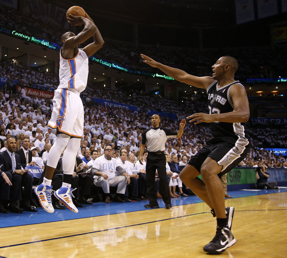Photo - Oklahoma City's Serge Ibaka (9) shoots a 3-pointer over San Antonio's Boris Diaw (33) during Game 6 of the Western Conference Finals in the NBA playoffs between the Oklahoma City Thunder and the San Antonio Spurs at Chesapeake Energy Arena in Oklahoma City, Saturday, May 31, 2014. Photo by Bryan Terry, The Oklahoman