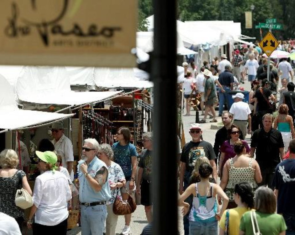 Event-goers look at art and performers at the 2010 Paseo Arts Festival in Oklahoma City.  Oklahoman archive photo