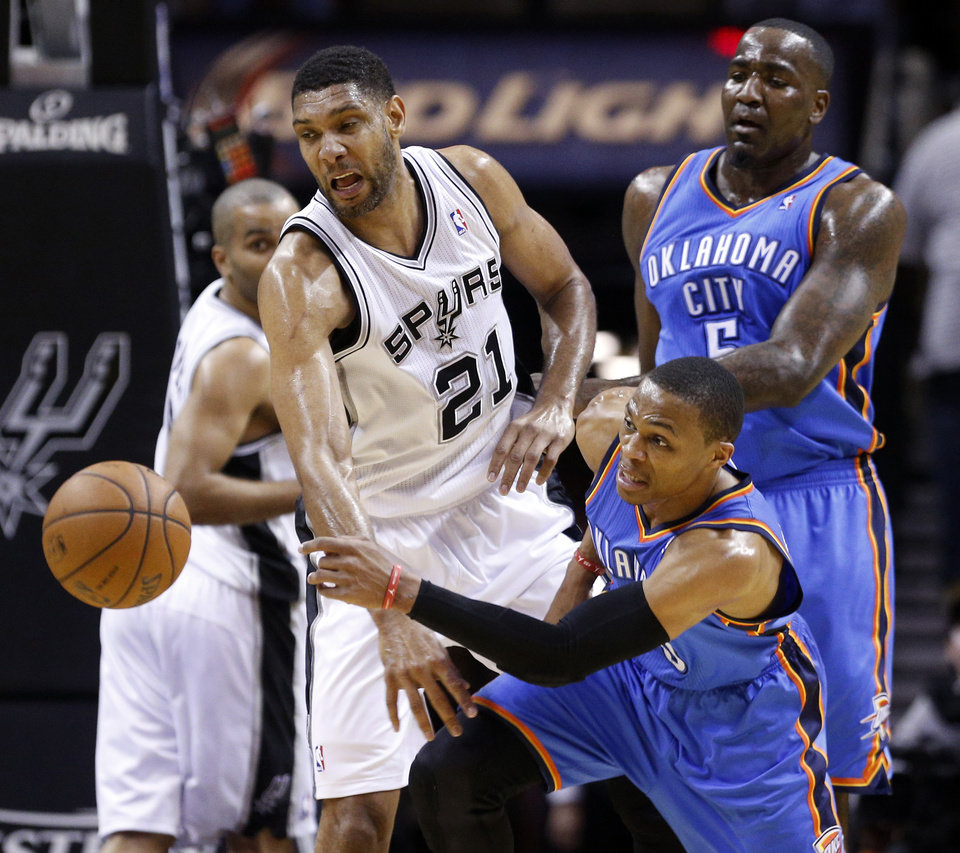 Oklahoma City's Russell Westbrook (0) and San Antonio's Tim Duncan (21) chase the ball near Oklahoma City's Kendrick Perkins (5) during Game 5 of the Western Conference Finals in the NBA playoffs between the Oklahoma City Thunder and the San Antonio Spurs at the AT&T Center in San Antonio, Thursday, May 29, 2014. Photo by Sarah Phipps, The Oklahoman