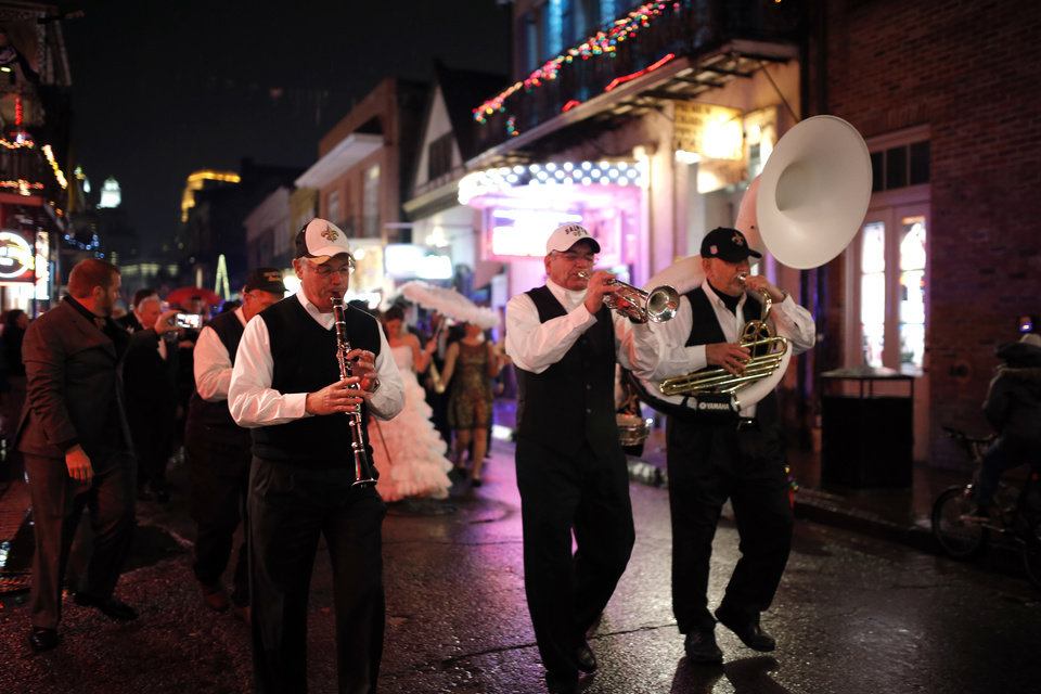A jazz band leads a wedding party down Bourbon Street in the French Quarter New Year's Eve, Tuesday, Dec. 31, 2013 in New Orleans. Photo by Sarah Phipps, The Oklahoman