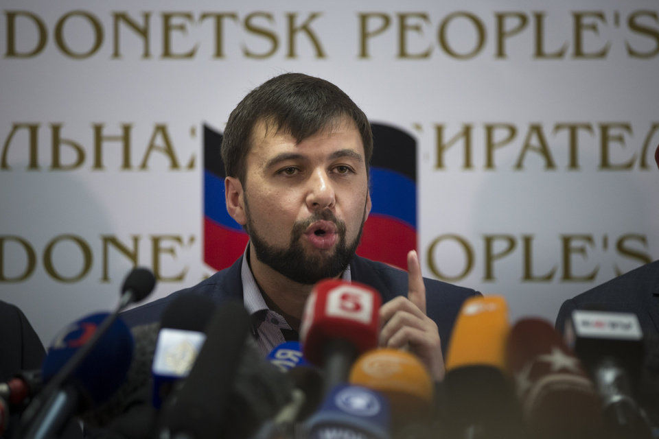 Insurgent leader Denis Pushilin speaks during a news conference in Donetsk, Ukraine, Monday, May 12, 2014. The referendum balloting Sunday in the Donetsk and Luhansk regions, which together have 6.5 million people, was condemned as a sham and a violation of international law by Kiev's interim government and other western powers. (AP Photo/Alexander Zemlianichenko)