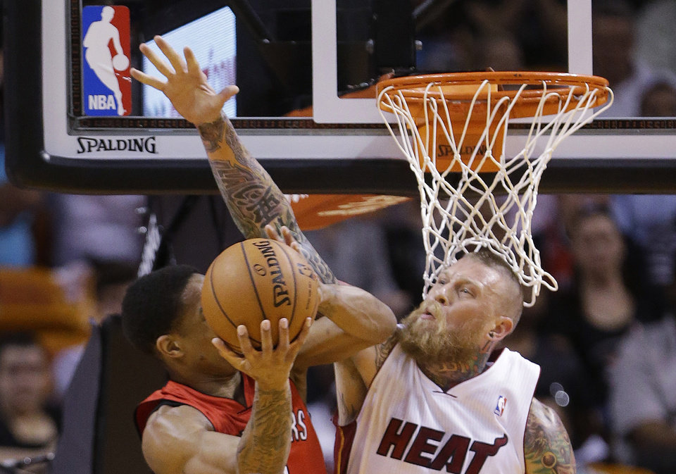 Miami Heat forward Chris Andersen, right, blocks a shot by Toronto Raptors guard DeMar DeRozan during the first half of an NBA basketball game, Monday, March 31, 2014 in Miami. (AP Photo/Wilfredo Lee)