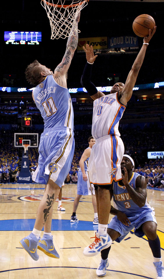 Oklahoma City's Russell Westbrook (0) goes to the basket between Denver's Chris Andersen (11) and Ty Lawson (3) during the NBA basketball game between the Denver Nuggets and the Oklahoma City Thunder in the first round of the NBA playoffs at the Oklahoma City Arena, Sunday, April 17, 2011. Photo by Bryan Terry, The Oklahoman