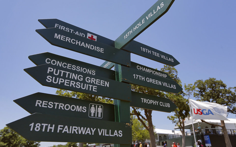 Photo - Direction signs along the course will point in every direction during practice rounds for the U.S. Senior Open golf tournament at Oak Tree National in Edmond, Okla. on Monday, July 7, 2014. Photo by Chris Landsberger, The Oklahoman