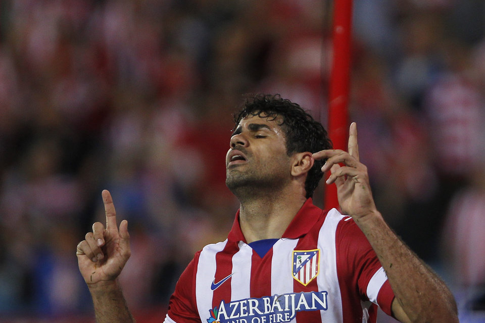Photo - Atletico's Diego Costa celebrates his goal during a Spanish La Liga soccer match between Atletico de Madrid and Elche at the Vicente Calderon stadium in Madrid, Spain, Friday, April 18, 2014. (AP Photo/Gabriel Pecot)