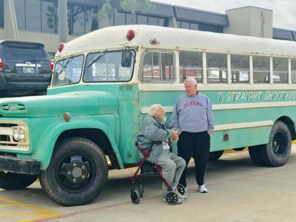 Photo -  Ron Wheeler and Leigh Nichols reminisce about the Straight Shooters youth ministry outside a vintage bus the ministry used to transport young people to church and different activities.  [Carla Hinton/The Oklahoman]