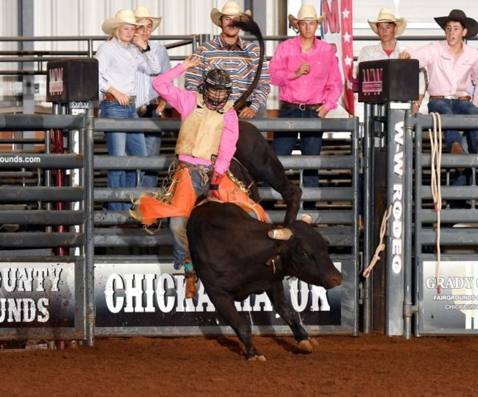 Photo -  Lukasey Morris, shown here in the Oklahoma high school finals rodeo in Chickasha in May, was seriously injured while competing in the bull riding at the National High School Finals Rodeo last week at the Lazy E Arena near Guthrie. Morris, 17, is recovering at home from a head injury. [HIRSCHMAN PHOTOS]