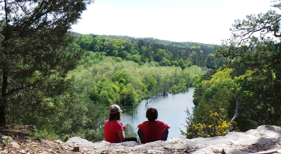 Photo - Brother and sister Ella and Ramey Brinkman sit on the bluffs overlooking the Lower Mountain Fork River in Beavers Bend State Park. PHOTO BY LILLIE-BETH BRINKMAN, THE OKLAHOMAN