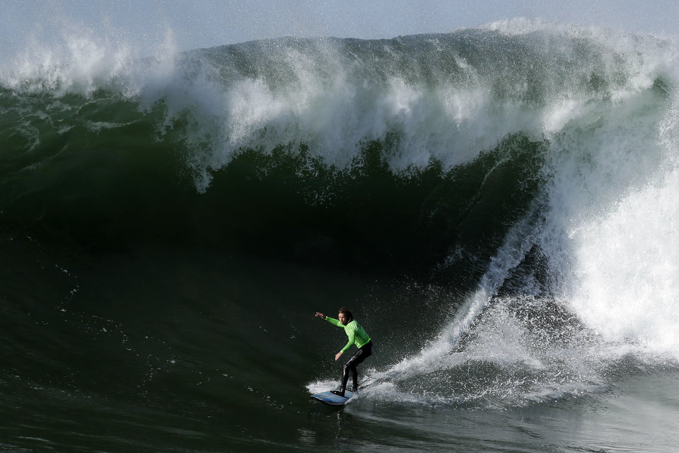 "Grant ""Twiggy"" Baker competes during the fourth heat of the Mavericks Invitational big wave surf contest in Half Moon Bay, Calif., Sunday, Jan. 20, 2013. (AP Photo/Marcio Jose Sanchez)"
