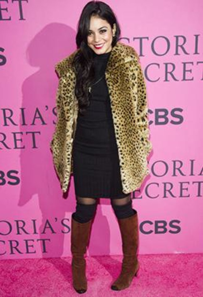 Photo - At the taping of the Victoria's Secret Fashion Show this month,Vanessa Hudgens hit the pink carpet in a knit dress and leopard print coat, braving the chill with stockings, leg warmers and knee high boots.