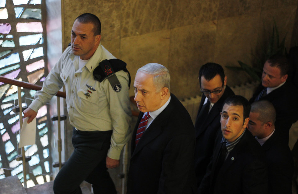 Israeli Prime Minister Benjamin Netanyahu arrives at his Jerusalem office for the weekly Cabinet meeting, Sunday, Jan. 27, 2013. (AP Photo/Ariel Schalit)