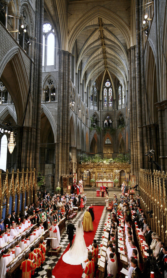 Photo - Kate Middleton, center right, accompanied by her father Michael Middleton, walks down the aisle at Westminster Abbey ahead of her marriage to Britain's Prince William, London, Friday, April 29, 2011. (AP Photo/Dave Thompson, Pool) ORG XMIT: RWDA11