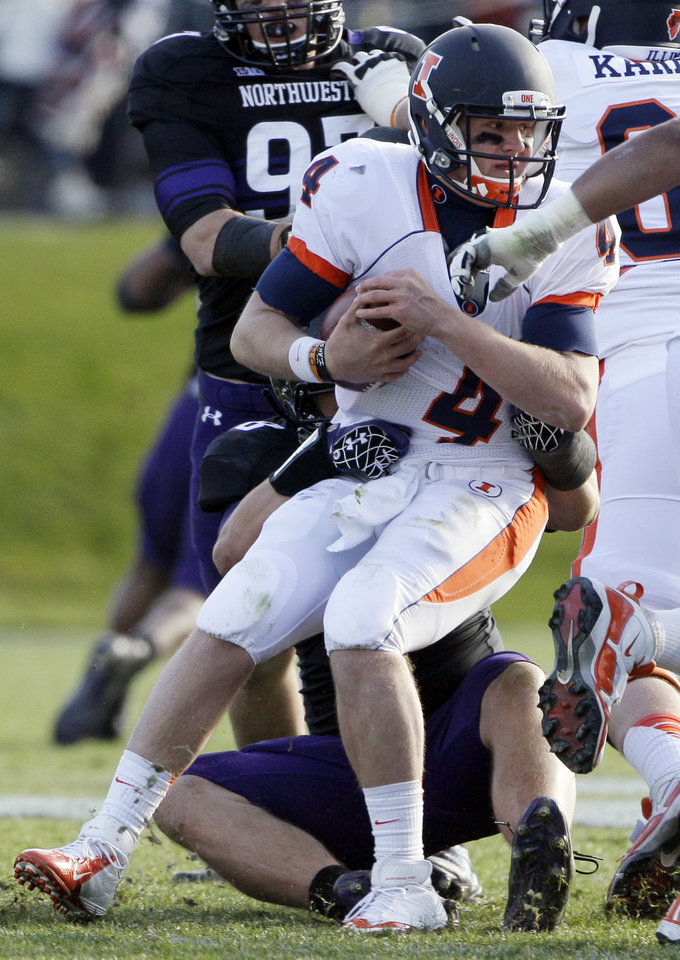 Photo -   Illinois quarterback Reilly O'Toole (4) is sacked by Northwestern defensive lineman Quentin Williams (88) during the second half of an NCAA college football game in Evanston, Ill., Saturday, Nov. 24, 2012. Northwestern won 50-14. (AP Photo/Nam Y. Huh)