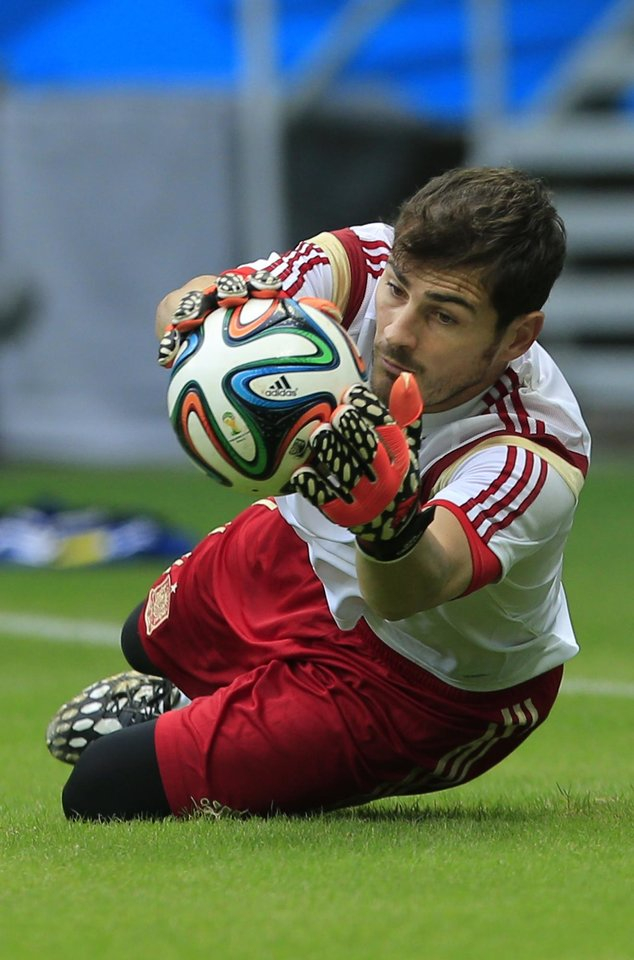 Photo - Spain's goalkeeper Iker Casillas stops the ball during an official training session the day before the group B World Cup soccer match between Spain and the Netherlands at the Arena Ponte Nova in Salvador, Brazil, Thursday, June 12, 2014.  (AP Photo/Bernat Armangue)