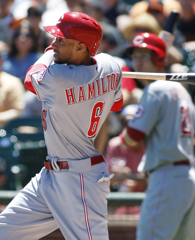Photo - Cincinnati Reds' Billy Hamilton hits an RBI single against the San Francisco Giants during the third inning of a baseball game, Sunday, June 29, 2014, in San Francisco. (AP Photo/George Nikitin)
