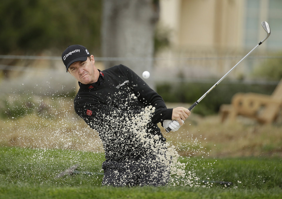 Photo - Jimmy Walker hits out of a bunker onto the second green during the final round of the AT&T Pebble Beach Pro-Am golf tournament, Sunday, Feb. 9, 2014, in Pebble Beach, Calif. (AP Photo/Eric Risberg)